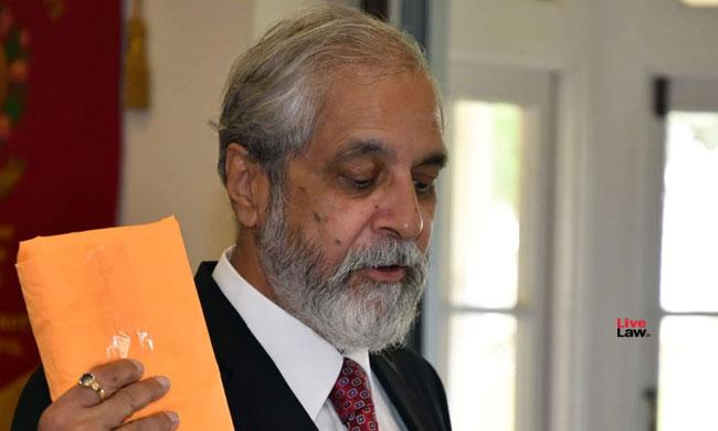 Justice Lokur taking oath on the Bhagavad Gita
